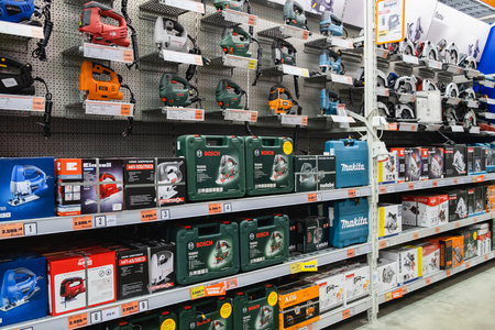 ST. PETERSBURG, RUSSIA - MARCH, 2019: shelf with power tools in the store OBI. Drills, screwdrivers.