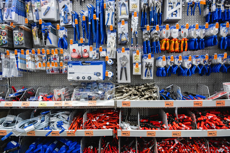 ST. PETERSBURG, RUSSIA - MARCH, 2019: shelf with power tools in the store OBI. Necessary tools for small repairs in everyday life.