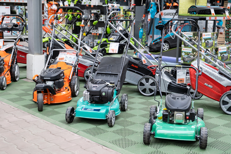 ST. PETERSBURG, RUSSIA - MARCH, 2019: Lawn mowers for sale. Many brands are recognizable Redakční