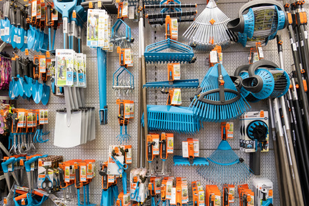 ST. PETERSBURG, RUSSIA - MARCH, 2019: shelf of a garden shop with the tools to care for a plot of land works.