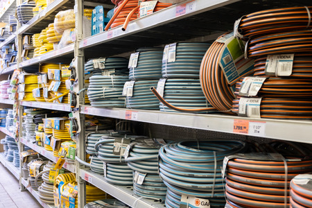 ST. PETERSBURG, RUSSIA - MARCH, 2019: supermarket shelves with a large selection of hose for irrigation.