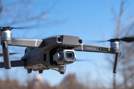 ST. PETERSBURG, RUSSIA - APRIL, 2019: DJI Mavic 2 pro with Hasselblad camera. Flight against blue sky in park