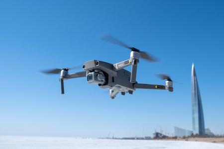 ST. PETERSBURG, RUSSIA - APRIL, 2019: DJI Mavic 2 pro with Hasselblad camera. Flight against blue sky