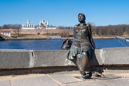 VELIKY NOVGOROD, RUSSIA - APRIL, 2019: Monument, called Tired woman tourist in Veliky Novgorod