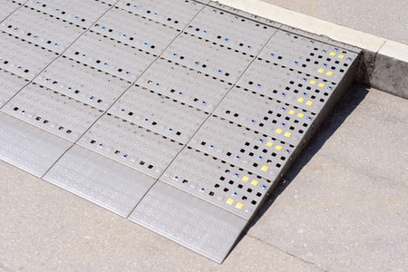 plastic diamond pattern ramp way for support wheelchair disabled people.