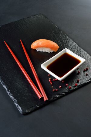 sushi sake, soy sauce, dark background