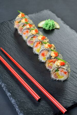 sushi rolls served on stone plate 写真素材 - 131536181