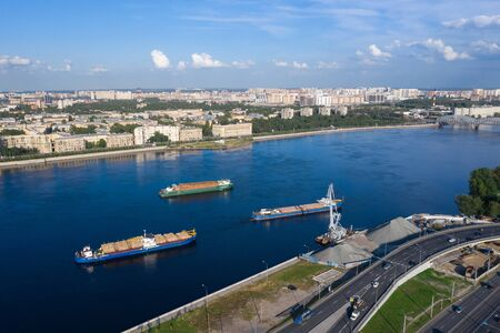 Cargo ships on the Neva in St. Petersburg. 写真素材 - 131536127
