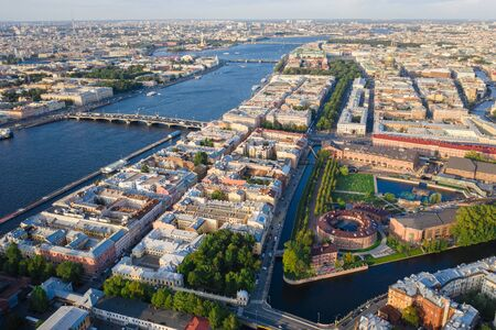 Aerial drone view of historical city, modern park between two artificial river channel, round building in the center, new Holland, Saint Petersburg, Russia 写真素材