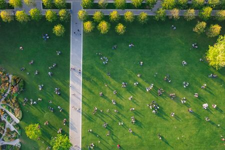 Top view of the many people are resting on the lawn in the park