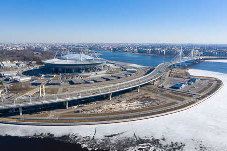 ST. PETERSBURG, RUSSIA - APRIL, 2019: Panoramic winter aerial view of the Zenith Arena stadium in St. Petersburg and its surrounding areas. Editorial
