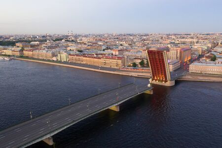 The divorced Liteyny Bridge in the early June morning. White nights in St. Petersburg. Russia