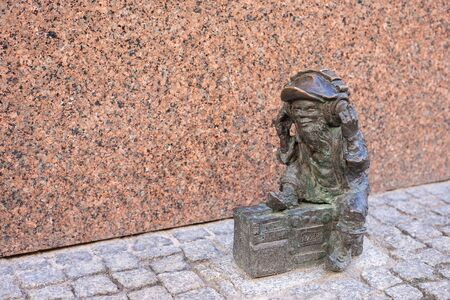 WROCLAW, POLAND - JUNE 17: Wroclaw Dwarf. The small figurines in the streets of town. Tourist attraction. Sight-seeing - Hunting for dwarfs. 350 gnome sculptures around the city.