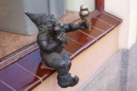 WROCLAW, POLAND - JUNE 17: Ice cream gnome or dwarf small statue in Wroclaw, Poland. Wroclaw has 350 gnome sculptures around the city.