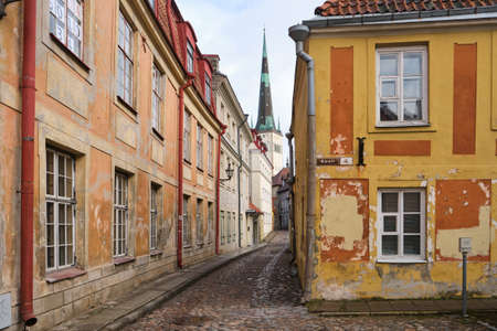 TALLINN, ESTONIA, FEBRUARY 2020: Old medieval streets of Tallinn, Baltic tourism center.