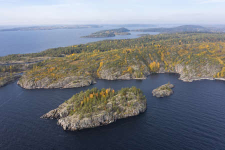 Russia. Karelia from the drone. Shooting Karelia from the air. Karelian landscape. Natural scenery. Ladoga skerries. Rocky island in lake Ladoga. Nature of Russia. Imagens