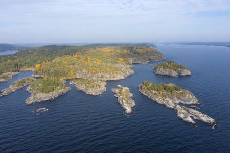 Karelia. Russia. Ladoga. The nature of Karelia. Skers in the Ladoga lake. Northern nature from the drone. Stone islets. Travel Russia. Vacation in Karelia.