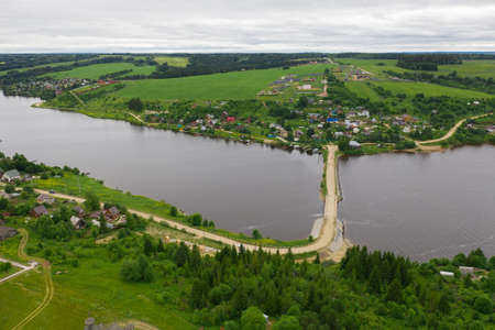 Aerial view of the Khokhlovka on the river of Kama. Perm Krai, Russia. River mouth, a village in Russia. Imagens - 157523008
