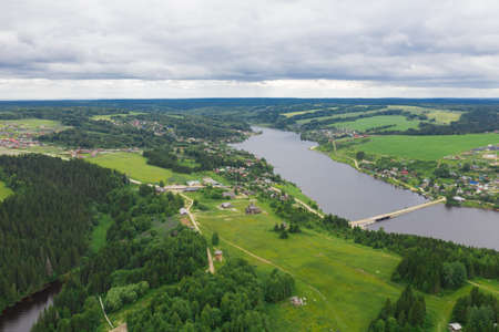 Aerial view of the Khokhlovka on the river of Kama. Perm Krai, Russia. River mouth, a village in Russia.