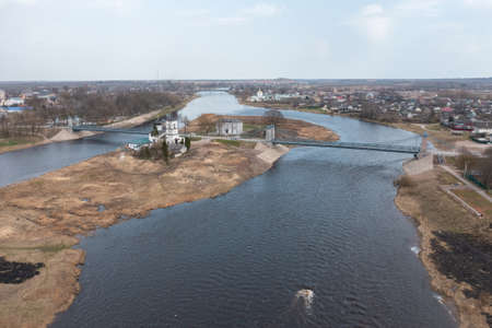 Drone view of a unique chain bridge and an island in the Velikaya river in the city of Ostrov, Pskov region. Tourist center of regional Russia. Imagens