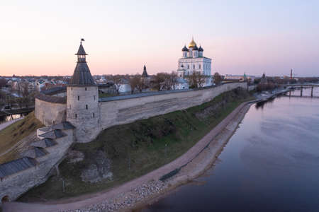 Bird eye view of the Pskov Kremlin and Trinity Cathedral and the Velikaya River. Sunrise.