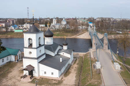 Drone view of the unique chain bridge and St. Nicholas Church in the town of Ostrov, Pskov region. Imagens