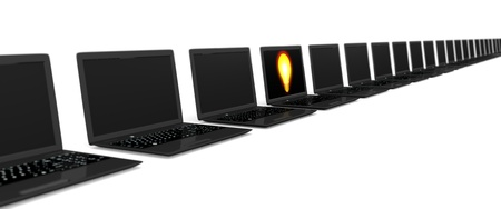 Image of a row of laptops and one laptop with a bulb displayed on the screen Stock Photo - 10832980