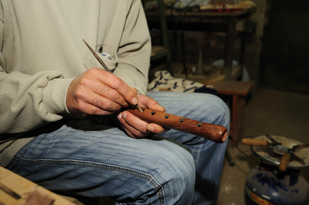 dexterity: realization of a particular craft lathe flute called duduk, the wood used and apricot. Central Asia,  Caucasus mountains,Armenia,