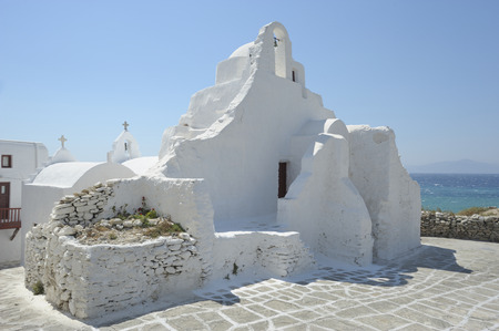 merged: the church of Paraportiani consists of 5 churches merged   together, built from 1475 to the seventeenth century in   Myconos, Greece, Europe.