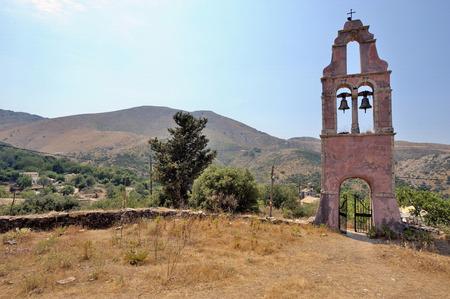 mysticism: belltower near the village of Perithia, in ancient village Perithia