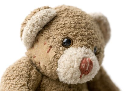 patched up: Patched teddy bear portrait - selective focus on the eye.