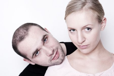 likable: Couple looking at camera - focus on her eyes.