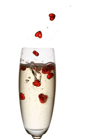 backlighting: Hearts falling down into champagne flute.
