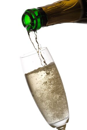 Pouring champagne, many bubbles. Isolated on white. photo