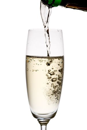 Pouring champagne. Isolated on white. photo
