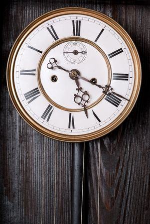 numerals: Old clock with roman numerals.