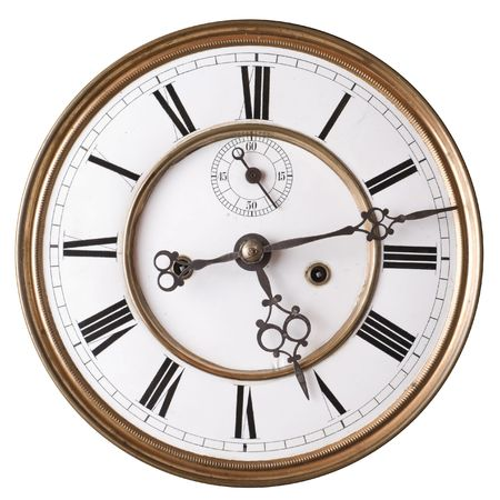 numerals: Old clock face with roman numerals isolated on white. Stock Photo