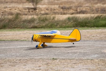 controlled: Remote controlled yellow airplane