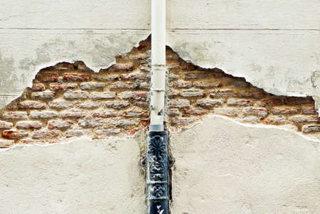 Detail of Old Brick Wall with paint pipe photo