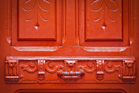 chipped paint: Vintage red door with chipped paint