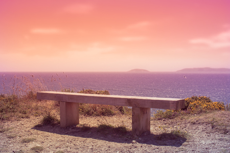 wooden bench at sunset