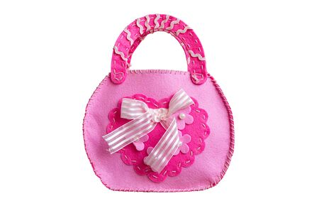 Pink baby bag sewn from scraps isolated on white background