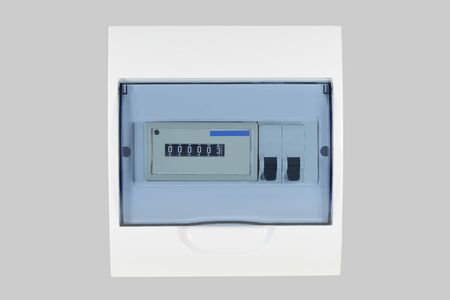 White plastic shield with electricity meter and circuit breakers for country house isolated on grey background