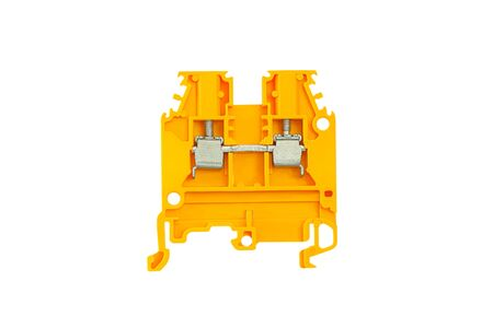 Yellow electrical terminal for connecting wires for DIN rail installation isolated on white background