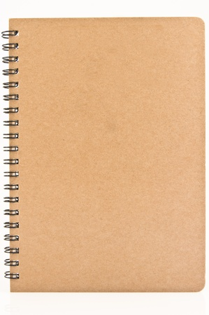 Brown plain closed notebook isolated photo