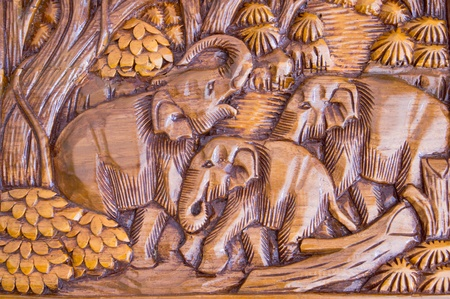 Elephant wood carving from Thailand. photo