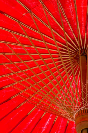 north thailand traditional red umbrella from ant eye viwe photo