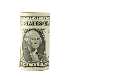 US dollars rolled on white background Stock Photo
