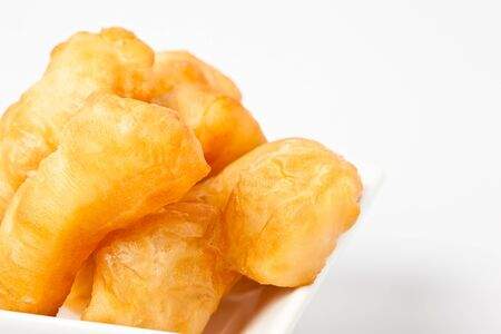 fried bread stick  isolated on white background photo