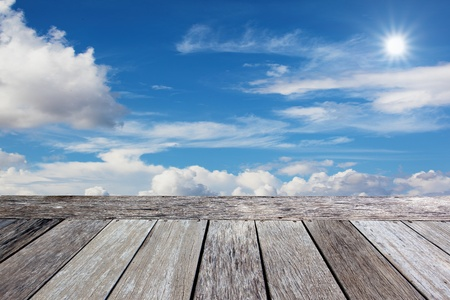 Wooden balcony in the blue sky background photo